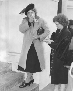 Aggie Underwood interviews a mourner at the funeral of L.A. evangelist Aimee Semple McPherson. [Photo courtesy LAPL.]