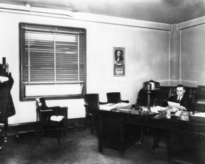 Coroner Frank Nance at his desk. [LAPL photo]