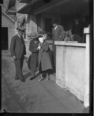 Mary Skeele recreates her kidnapping for detectives. [Photo courtesy of UCLA Digital Archive.