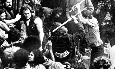 Hell's Angels attacking a concert goer at Altamont.