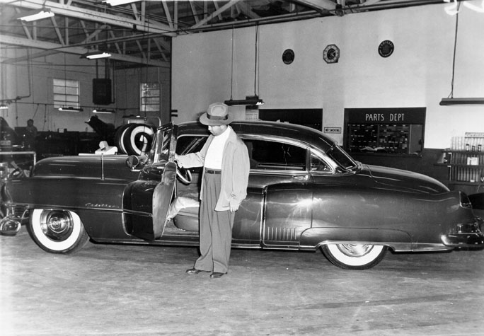 Mickey Cohen and his bullet proof car.