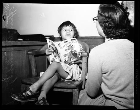 Florence with her back to the camera, befriends a lost girl c 1954 [Photo courtesy of USC Digital Archive]