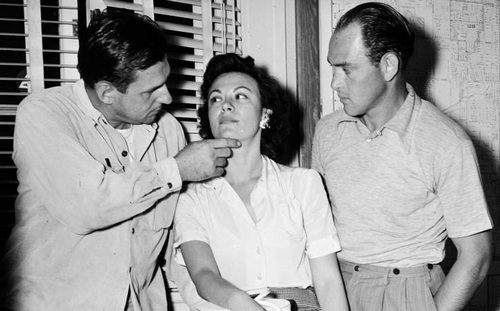 Florence shows off her injuries to colleagues. [Photo courtesy USC Digital Archive]