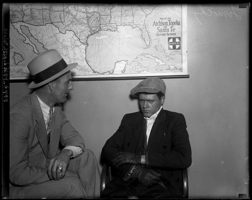 Timothy Blevins, glowering during questioning by an unnamed LAPD detective.  [Photo courtesy of UCLA Digital Collection]
