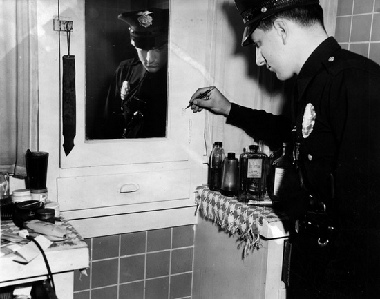 Seeking evidence in Mark Hansen's bathroom. [Photo courtesy of LAPL]