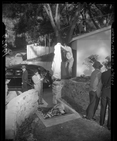 Sam Rummel dead in his driveway. Photo courtesy of LAPL.