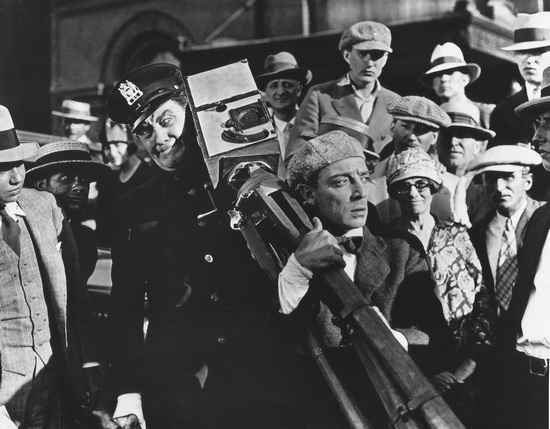 Buster Keaton in THE CAMERAMAN emulates real life newspaper photogs trying to get a scoop.