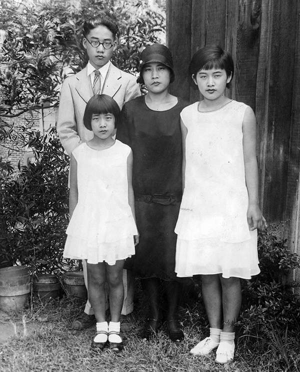 "Photograph caption dated September 3, 1929 reads, ""Photo shows Mrs. Karuko Rokumoto, the crash victim's widow, and her three children bereft by the tragedy. At left, William Rokumoto, in foreground Grace, left, and Mary Rokumoto. Mother and son are prosecution witnesses.""  (Photo courtesy LAPL0"