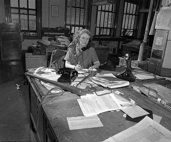 Aggie at her desk c. 1949. Photo courtesy LAPL. [Yes, that it a baseball bat on her desk. Aggie had a way of dealing with overzealous Hollywood agents.