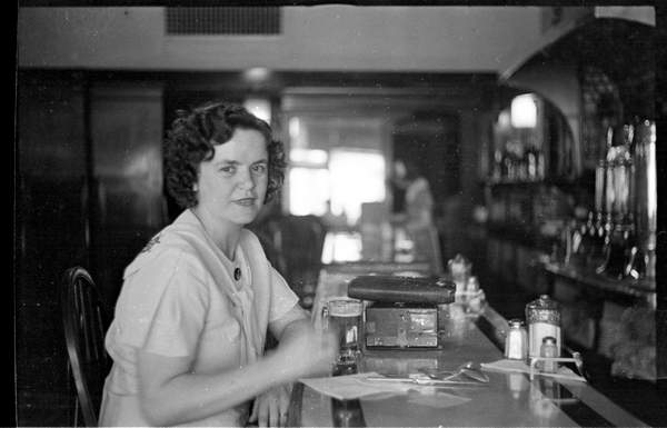Aggie hoists a brew c. 1920s.