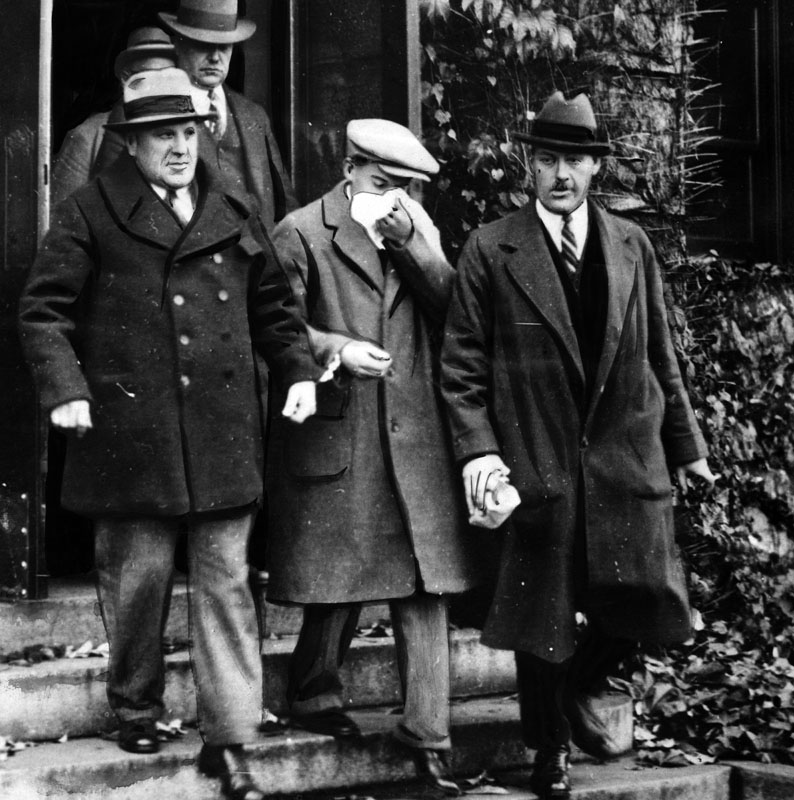 Northcott, center, is shown shackled to Constable F. R. Rigby of the Canadian police. At the right is Corporal Walker Cruickshank, also a member of the Canadian police force. Northcott arrived in Los Angeles November 30, 1928, and was placed in the cell Hickman occupied at the County Jail.  [Photo courtesy LAPL]