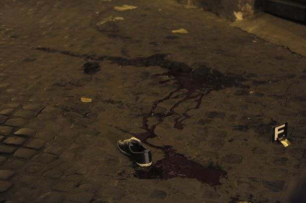 A shoe is seen next to a pool of blood after a fight in downtown Rome-1450028