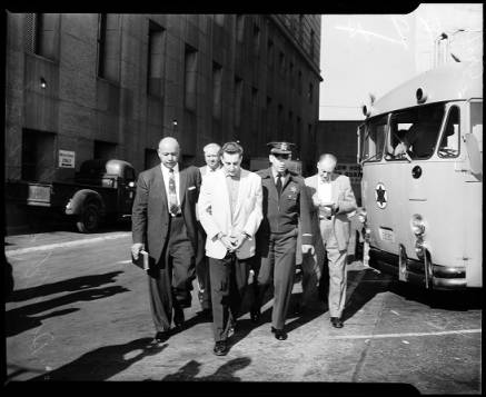 "Photograph by Edward Gamer / Los Angeles Times Senior Deputy George Coenen, left, and Sgt. Howard Earle, right, escort convicted killer Donald Keith Bashor on his trip to San Quentin, Oct. 25, 1956. Bashor's story was the basis of a ""Playhouse 90"" episode by Jules Maitland. Bashor's slaying of Graham also plays a prominent role in Jack Webb's ""The Badge,"" a not terribly accurate book reissued in 2005."